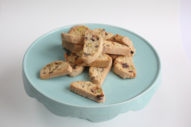 Image showing a cake plate with a pile of our homemade cantuccini biscuits. Image used as a link to more information about our homemade snack offerings.